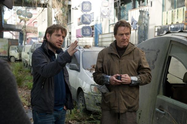 Gareth Edwards with Bryan Cranston on set of GODZILLA.