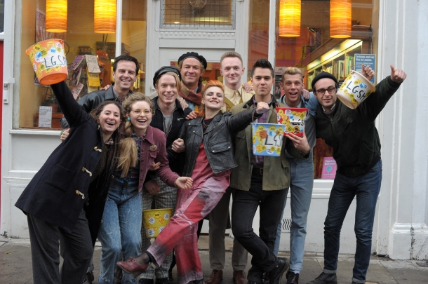 Picturehouse Podcast guests Ben Schnetzer and Faye Marsay in the centre (holding buckets) alongside their fellow cast members.